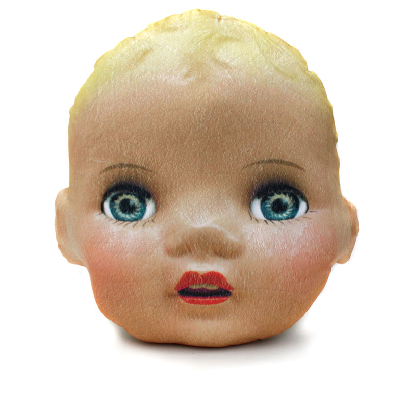 large doll head pillow with blue eyes