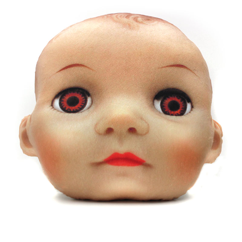 large doll head pillow with brown eyes