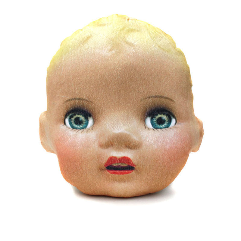 small doll head pillow with blue eyes