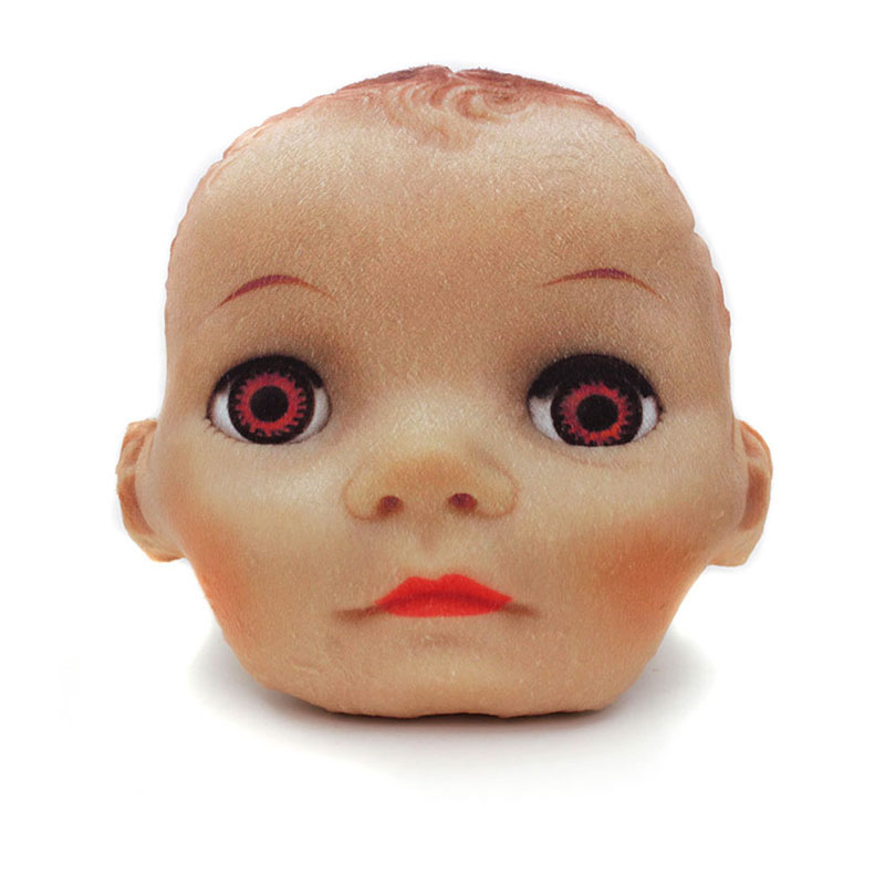 small doll head pillow with brown eyes